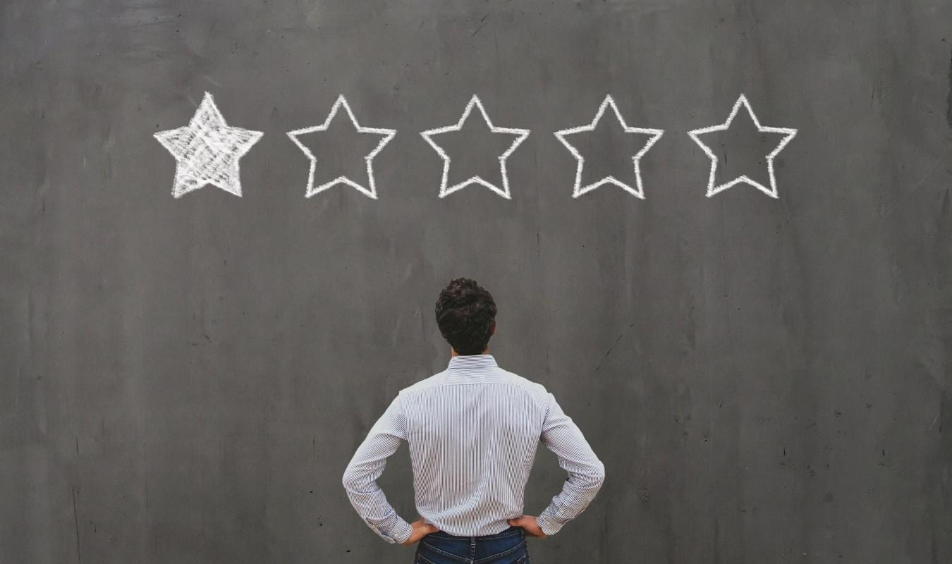 customer touching a review button for five stars - computer illustration
